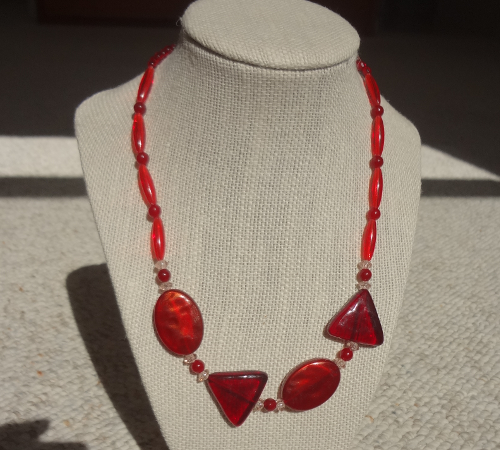 red-triangle-oval-neckles